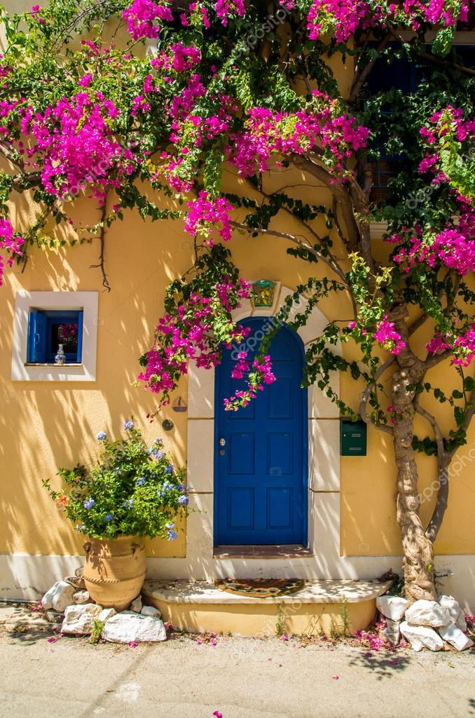 traditional greek house with flowers in assos, kefalonia island