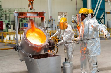 Smelting in a metallurgical plant. Molten metal spill