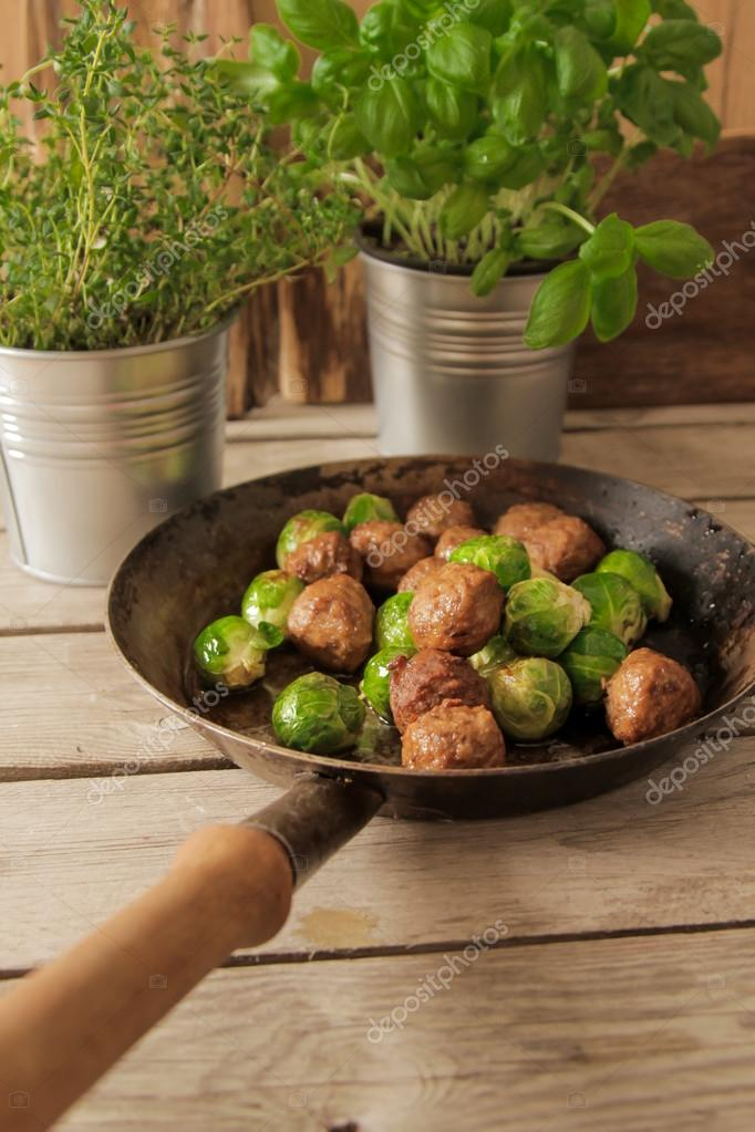 meatballs with cabbage and basil in a pan