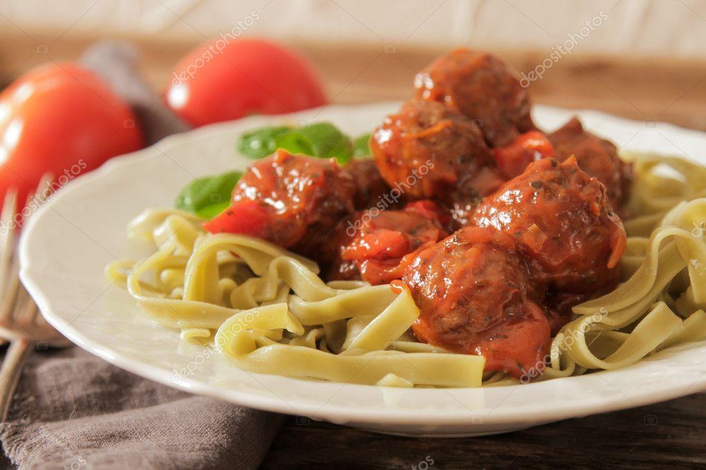 meatballs, tomato sauce in the Tagliatelle and basil