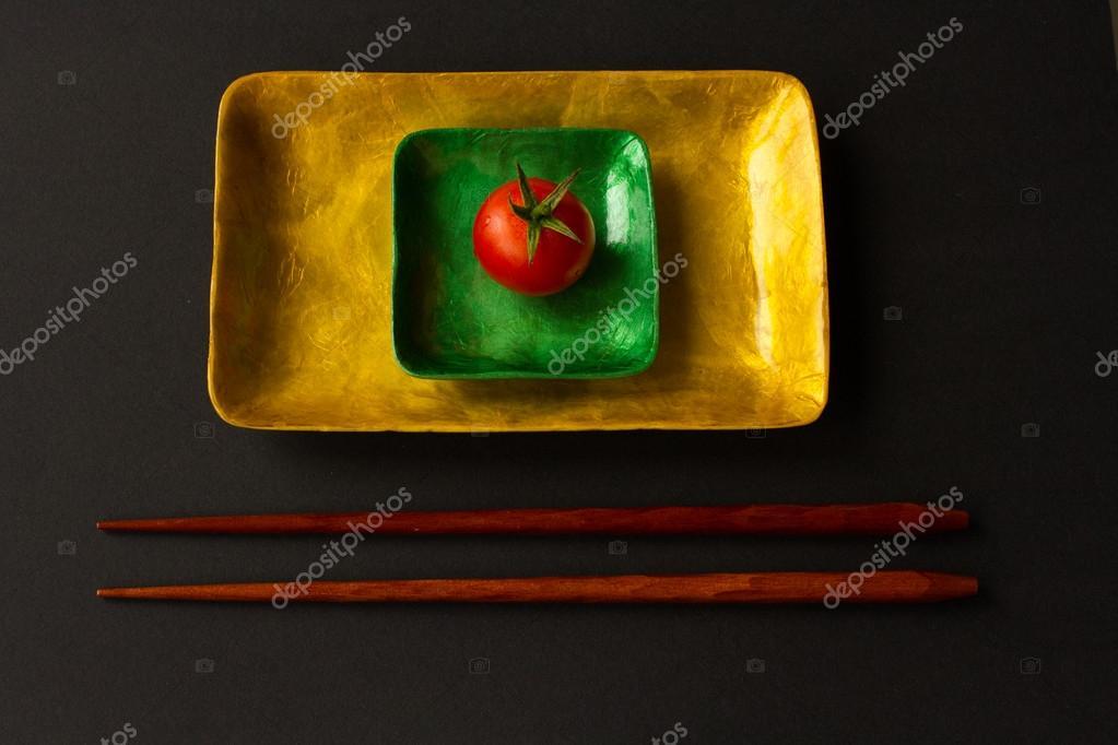 Diet for girls. lettuce and tomato on a platter