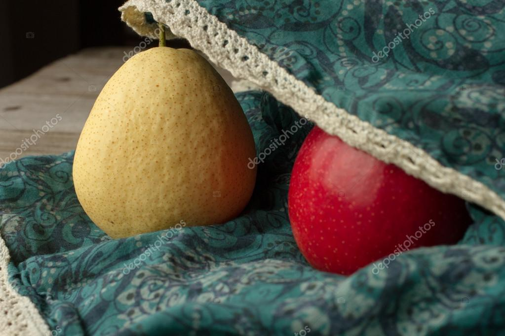 Pear with apples on a brown background. paradise for diet