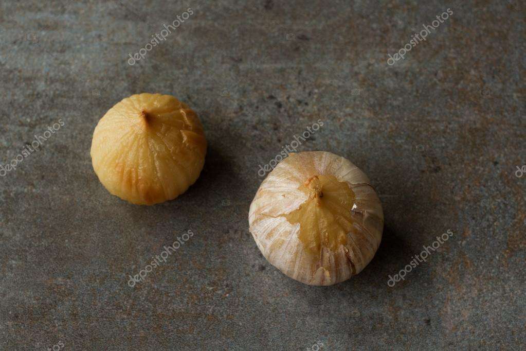 Roasted garlic on a gray background. Dietary cuisine