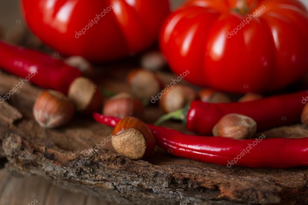 Tomatoes with hazelnuts wood texture as a basis