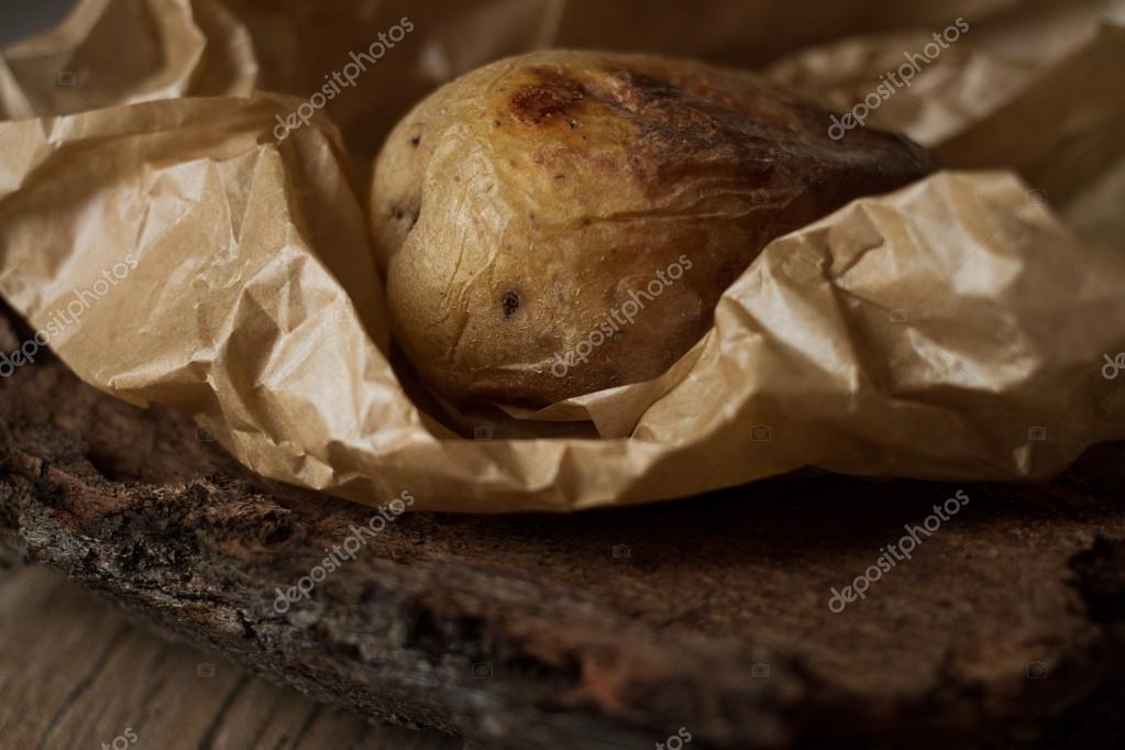 Baked potatoes on the grill. wrapped in baking paper