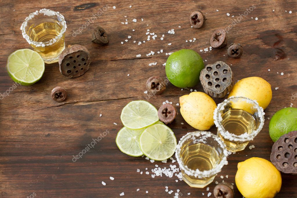 tequila lime and lemon on a wooden table
