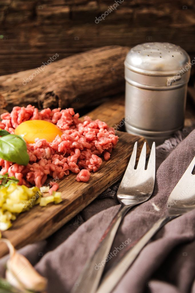 beer snack Beef tartare with pickled cucumber and fresh onion