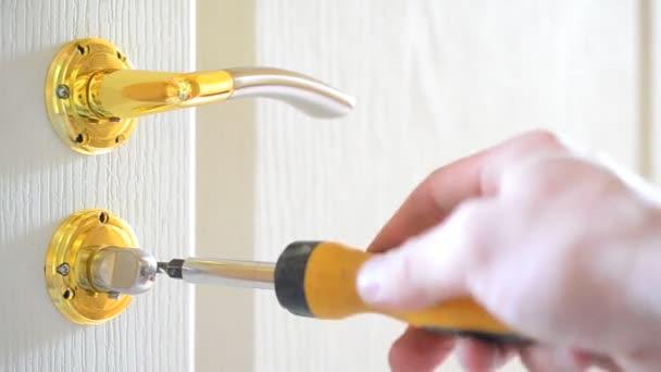 Mounting a mortise door lock. Fastening screws of door handles
