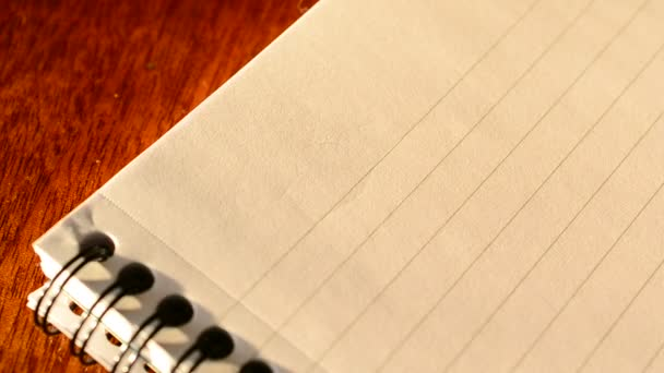 Hand writing TO DO list with a pen in notepad