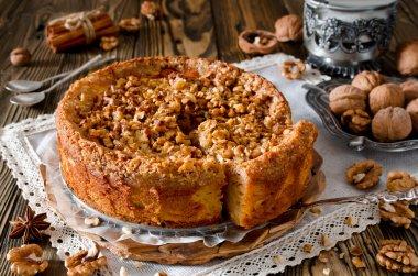 Piece of apple pie with walnut and sugar glaze