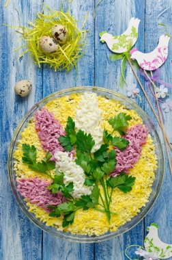 Salad with chicken and mushrooms decorated with sprigs of lilac