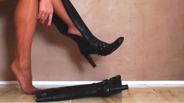 Woman Putting on Black Boots
