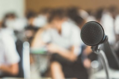Microphone voice speaker with audiences in seminar classroom, lecture hall or conference meeting in educational business event for host, teacher, or coaching mentor