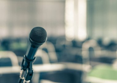 Microphone speaker in school lecture hall, seminar meeting room or educational business conference event for host, teacher or coaching mentor