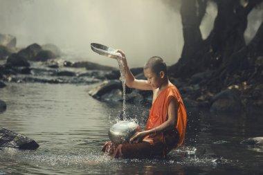 Novice on the creek playing water splash.