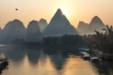 Traditional Chinese Sunrise Landscape with Water and Mountains