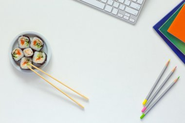 Top View of Office Work Place on white Desk with Sushi