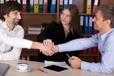 Group of happy young Business People shaking Hands