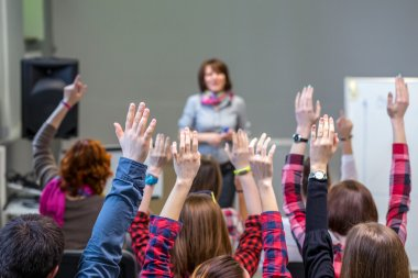 Active Students raising Arms up ready to answer Teachers Question