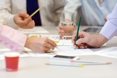 Business Team networking - office Table with Charts and People Hands