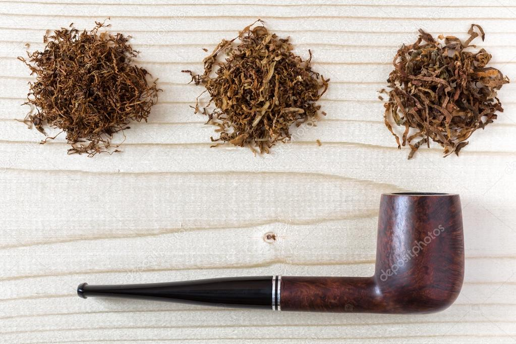 Three different sorts of finer and larger cuts Tobacco and simple straight Pipe on natural wood Background u2014 Photo by AlexBrylov & Three different sorts of Tobacco and Pipe on wood Background u2014 Stock ...