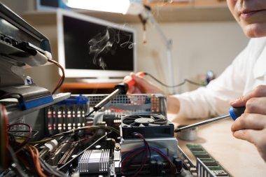 Computer Technician fixing Hardware using tools in Service Workshop stock vector