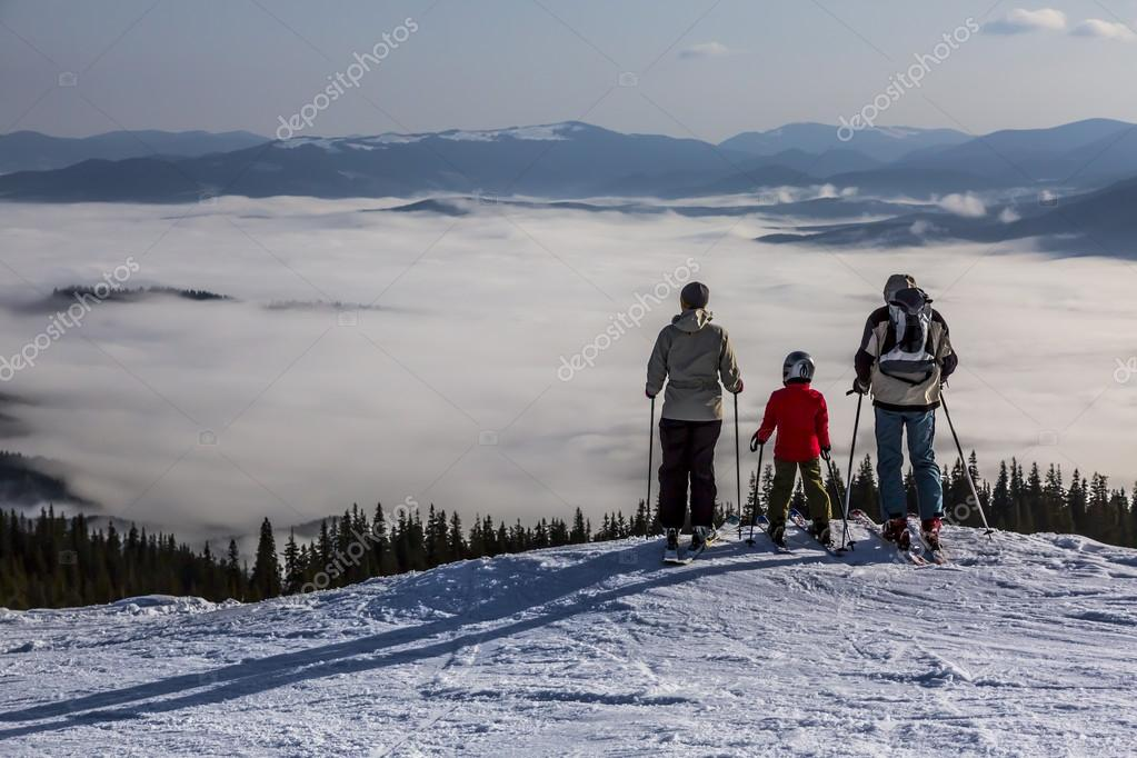 People observing mountain scenery