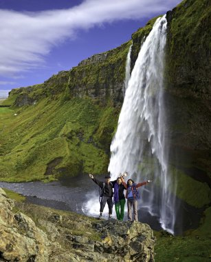 Group of climbers on the waterfall background