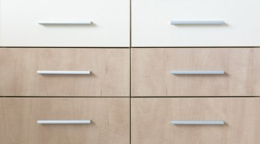 Cropped cabinet with six symmetric drawers