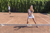 Two athletes on tennis court