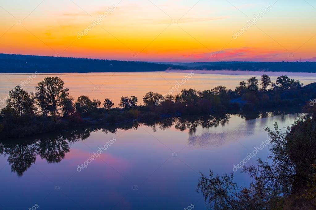 Amazing orange dawn on blue lake
