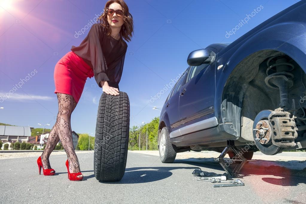 Le BO nouveau est presque arrivé... - Page 20 Depositphotos_77522370-stock-photo-leggy-female-changing-wheel-of