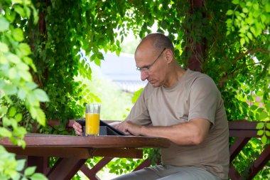 Working man in wooden arbor