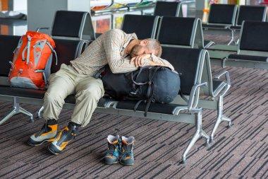 Sleeping man inside transport terminal