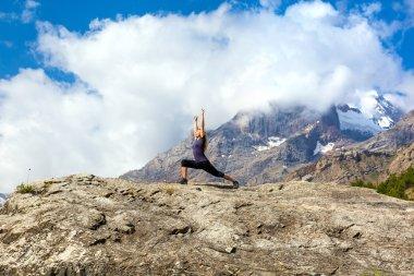 Female athlete makes yoga asana