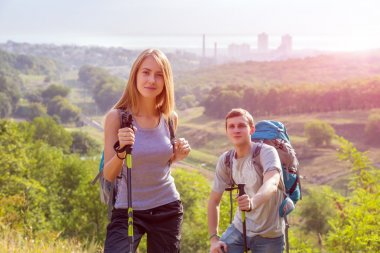 Excited Hikers Young Man and Woman Traveling Outdoor