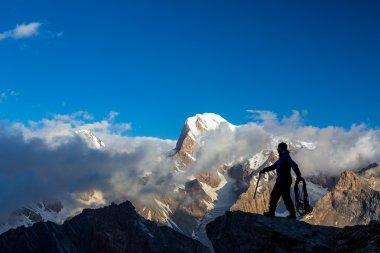Alpine Climber Reaching Summit