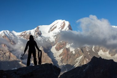 Alpine Climber Arranging Descent with Rope and Ice Axe