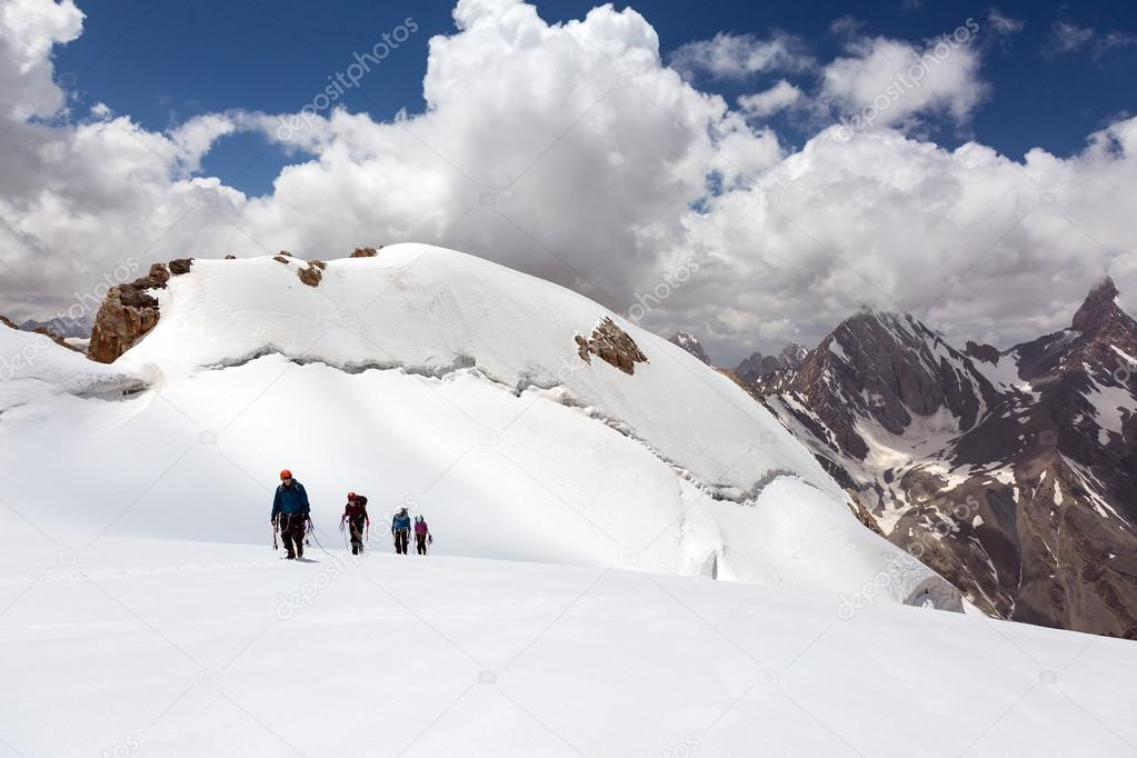 Group of Mountaineers Walking on Ice Field