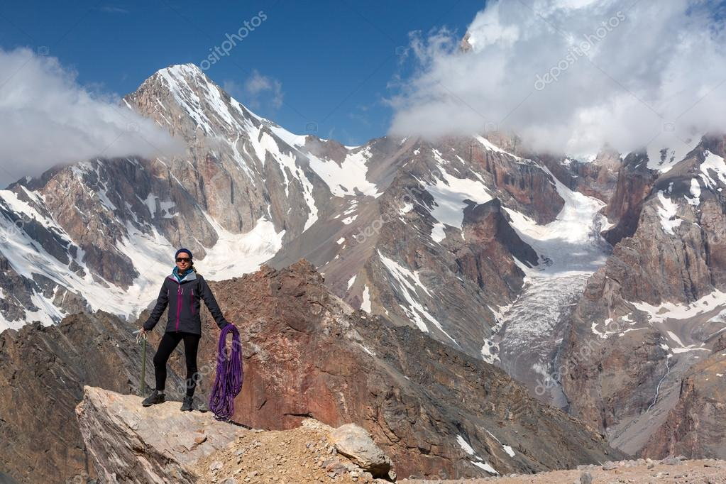 Female Climber Holding Ice Axe and Alpine Rope