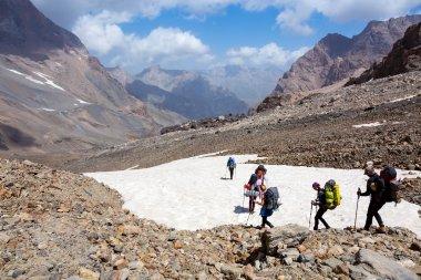 Group of Hikers Walking on Snowfield