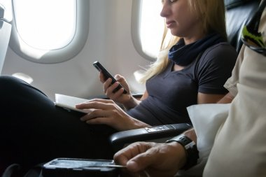 Air Flight Passenger Sitting in Aircraft