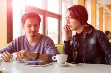 Young Couple at Coffee Shop Interrupting