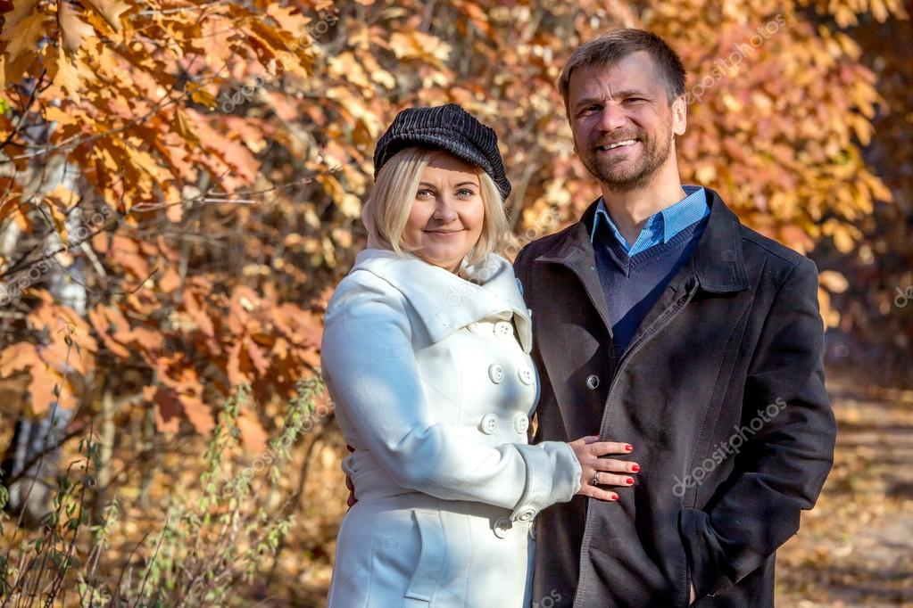 Portrait of Middle Aged couple in Autumnal Park