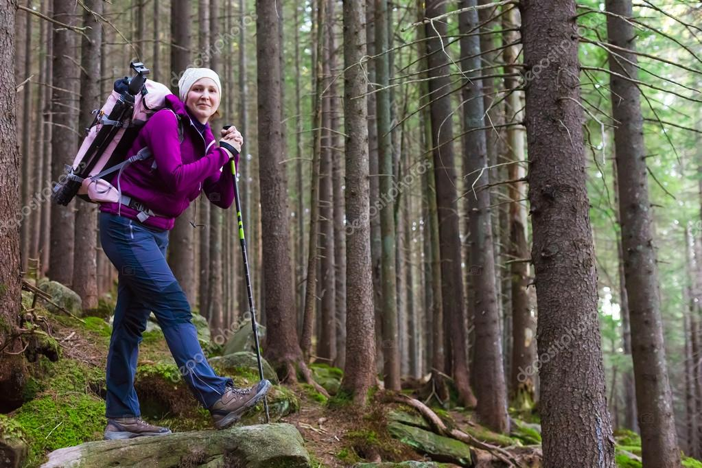 Smiling Female Hiker Staying in Deep Old Forest