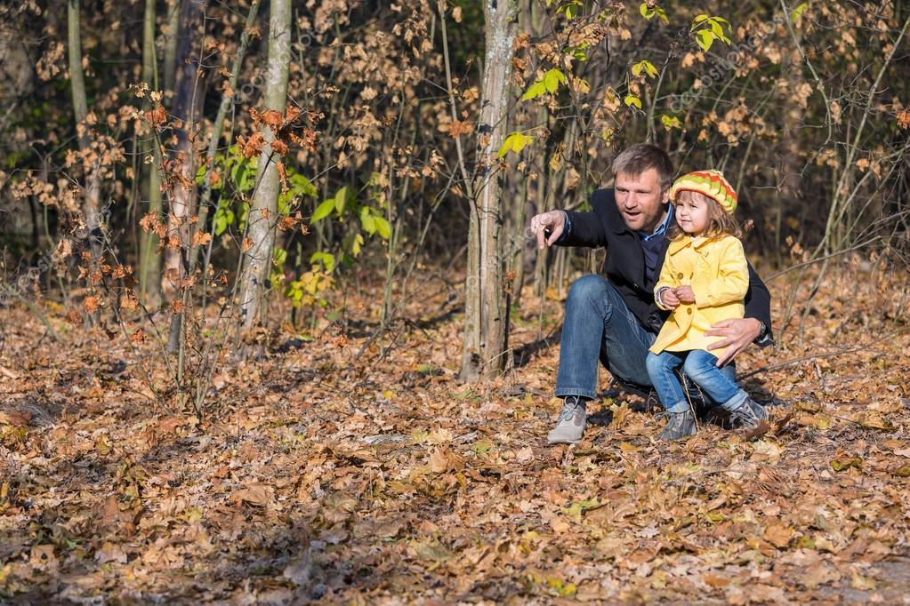 Father Playing with Little Baby Daughter in Autumnal Forest