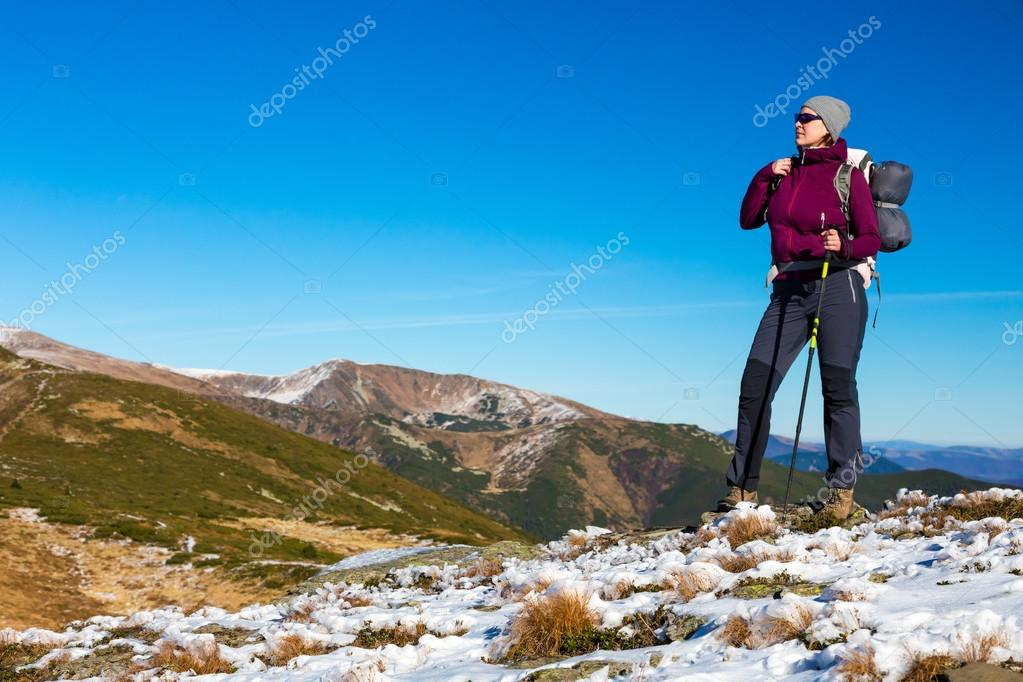 Female Hiker Staying on Mountain Trail and Enjoying Nature