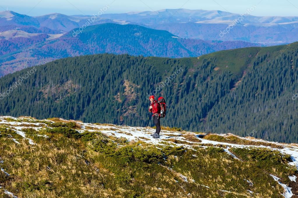 Energetic male Hiker Staying on Trail and Observing Scenic Mountain View