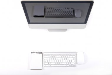 Top View of Working Place of Designer with large Computer Monitor Keyboard Notepad and Mouse on White Desk with Gadgets Reflection on Screen stock vector