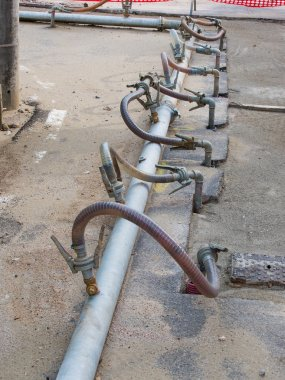 temporary metal pipes cross the road